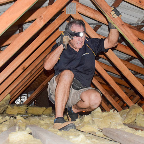 Glen conducting inside roof inspection