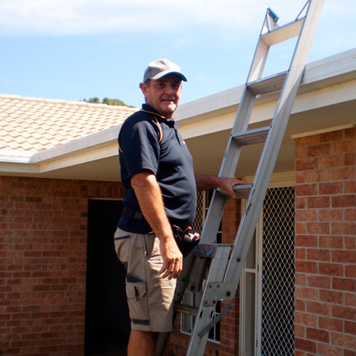 Glenn building pest inspector on ladder