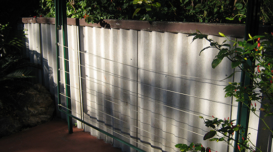 Common super 6 fencing (asbestos)