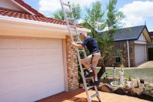 building inspector climbing ladder