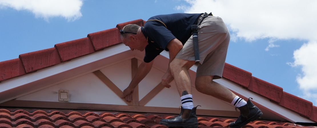 Independent building inspector performing inspection